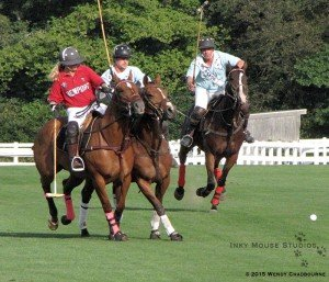 Polo players challenging for the line of the ball